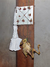 Photo: an offering of a whole chicken to the wall spirits in Yeng's home