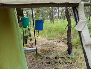 Photo: 20 liters warm water for each person for evening shower, heated in iron kettle.