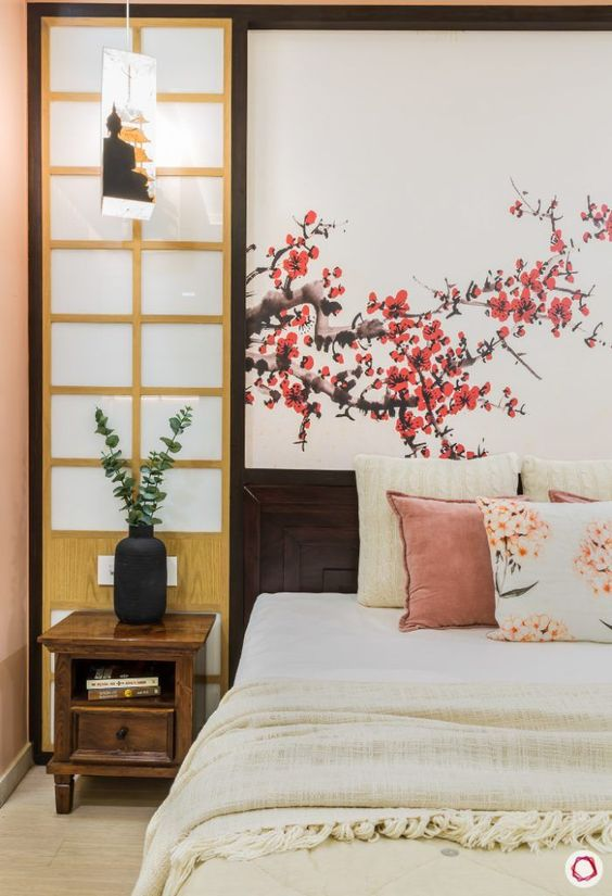 Pink Cherry Blossom mural and pillow with a Buddha pendant light beside bed