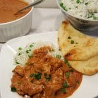 Pressure Cooker Chicken Tikka Masala with Butter Rice and Peas.