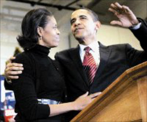 HIGH HOPES: Democratic presidential hopeful Barack Obama and his wife Michelle. Pic. M Spencer Green. 02/01/2008. © Sowetan.