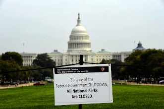 """Photo: A closure sign is posted on the national mall near the US Capitol in Washington, DC, October 3, 2013, as seen during the third day of the federal government shutdown. US President Barack Obama on October 3, directly attacked Republican Speaker John Boehner, saying he could end a """"reckless"""" US government shutdown in just five minutes. AFP Photo/Jewel Samad        (Photo credit should read JEWEL SAMAD/AFP/Getty Images)"""