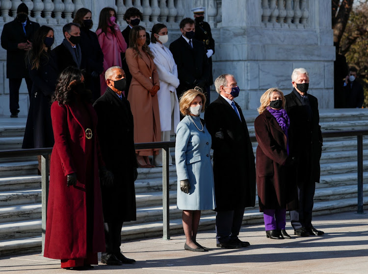 Former US President Bill Clinton with his wife, former Secretary of State, Hillary Clinton, former US President George W. Bush with his wife Laura Bush, and former US president Barack Obama and his wife Michelle Obama wait for US President Joe Biden at the Arlington National Cemetery, in Arlington, Virginia, US, January 20, 2021.