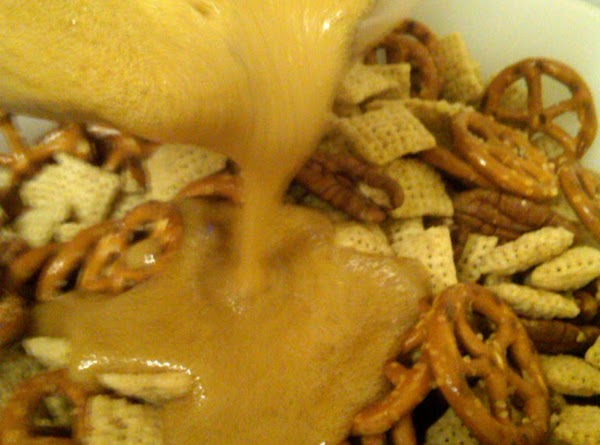 Stir in vanilla and baking soda & pour over the Rice Chex mixture. Toss...