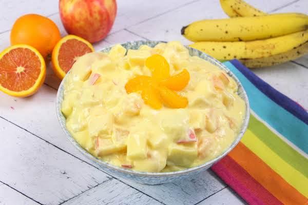 Orange Cream Fruit Salad In A Serving Bowl.