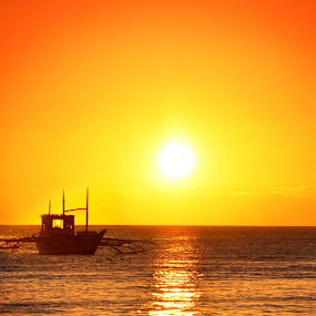 sunset by Philip Familara - Landscapes Sunsets & Sunrises ( water, orange, ocean, travel, beauty in nature, beauty, beach, yellow, scenic, boat, island, vacation, sunset, boracay, philippines, golden hour,  )