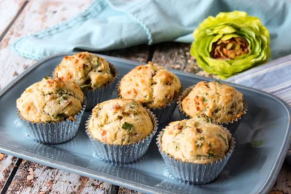Six Ham And Spinach Muffins On A Plate.