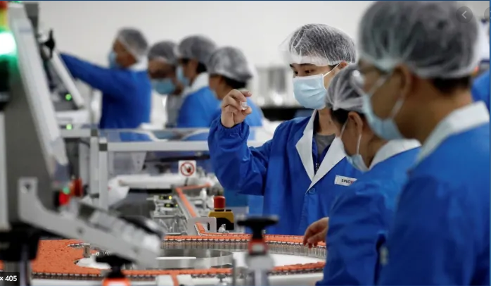 Workers at the packaging facility of the Chinese vaccine maker Sinovac Biotech, developing an experimental coronavirus vaccine in Beijing, China.
