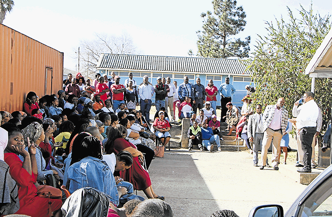 Protesting parents of Schornville Primary pupils are addressed by department of education provincial heads yesterday.
