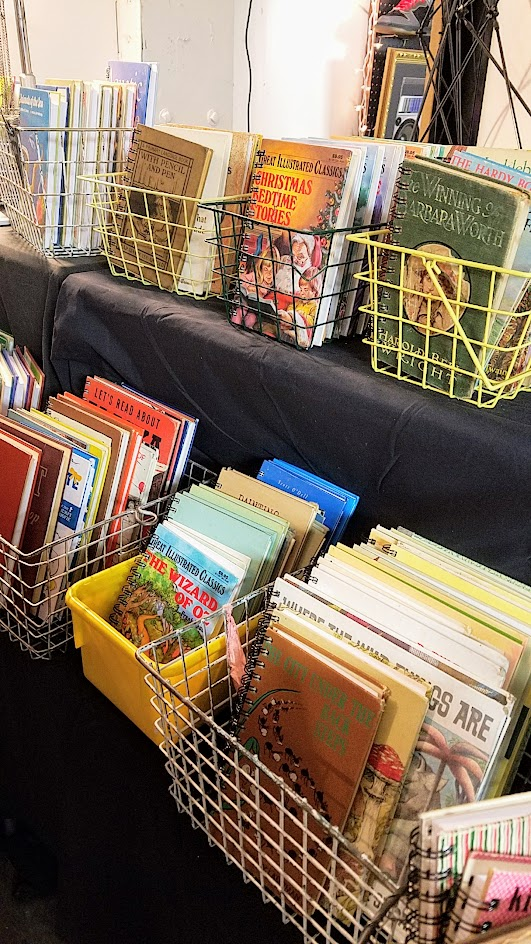 Notebooks made of children books at a booth as part of the vibe of the Portland Night Market, held every few months in the Central Industrial District in a warehouse, during the November 2016 market