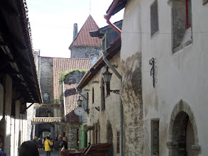 Photo: Tallinn is filled with interesting architecture including some of the old city wall and a tower in the background.