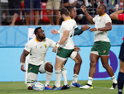 South Africa's captain Siya Kolisi celebrates with team mates scoring a try.
