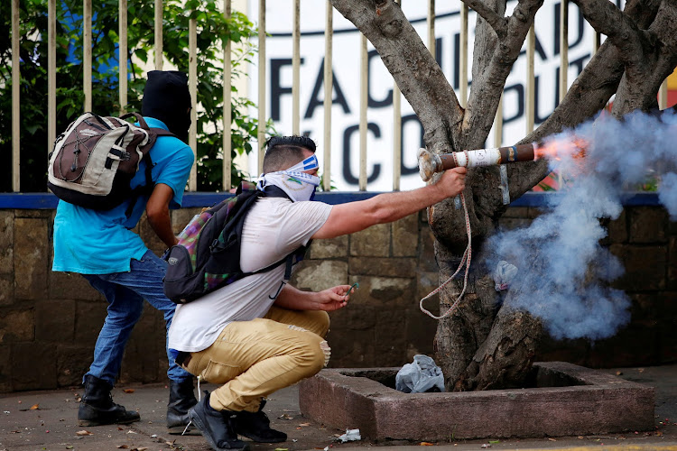 A demonstrator fires a homemade mortar towards riot police during a protest against Nicaragua's President Daniel Ortega's government in Managua.