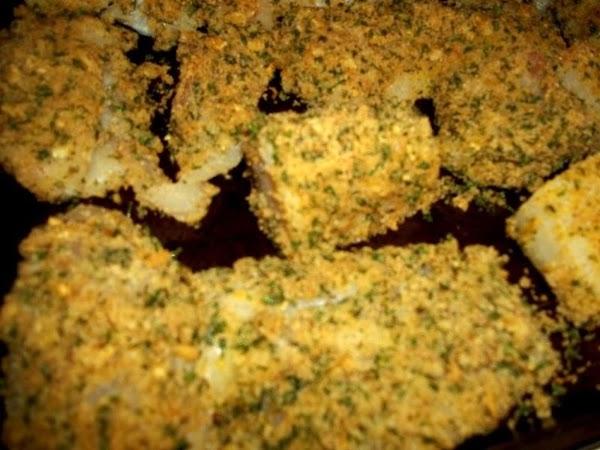 Dredge each fish fillet in the beaten egg first.  Then dredge each fish fillet into...