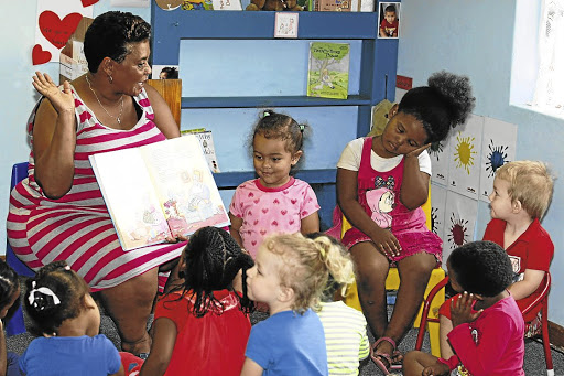 Mobilising: Children who attend the Smiley Kids preprimary school in Walmer, Port Elizabeth, celebrate World Read Aloud Day in this file photograph. The annual event is aimed at drawing attention to the importance of reading aloud and sharing stories. Picture: FREDLIN ADRIAAN
