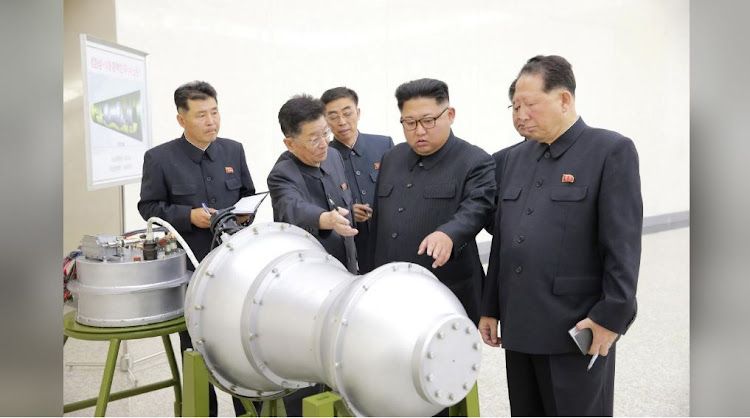 Kim Jong-un with warhead. Picture: REUTERS