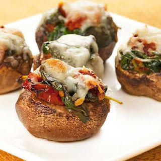 Spinach and Sun-Dried Tomato Stuffed Mushrooms.