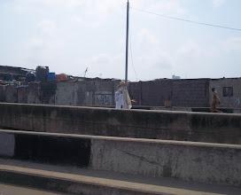 Photo: Eyo on the bridge