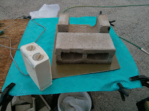 Photo: using cement blocks as weight while the epoxy between the FRP & plywood cures.