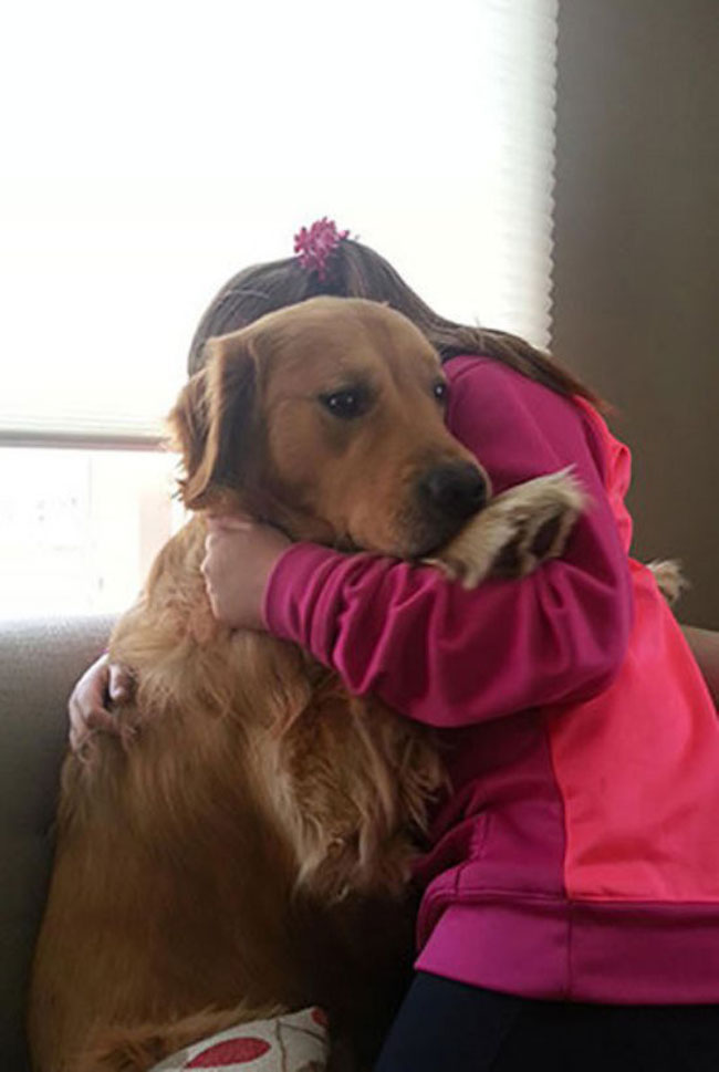 cute-girl-hugging-scared-dog