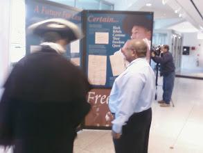 Photo: Reenactor and display designer at exhibit