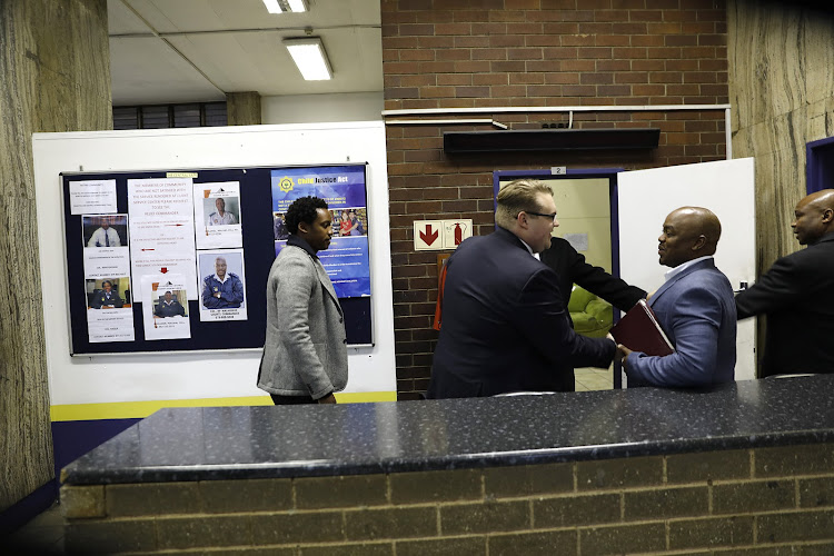 Duduzane Zuma, left, at the Johannesburg Central police station. Picture: ALON SKUY