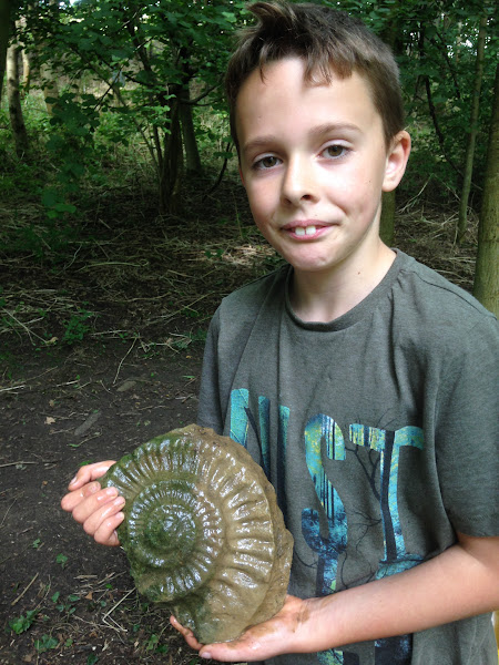 Photo: Thanks to this picture from EcoWild who ran activity sessions in and around Priston in early August 2016. It shows Jed, one of the EcoWild participants, with an impressive ammonite find. © EcoWild 2016