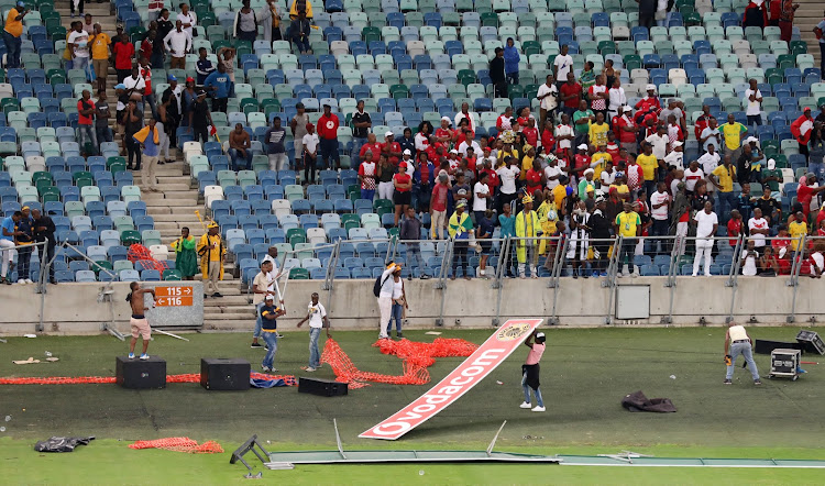 Fans vandalizing the stadium during the 2018 Nedbank Cup match between Kaizer Chiefs and Free State Stars at Moses Mabhida Stadium, Durban on 21 April 2018.