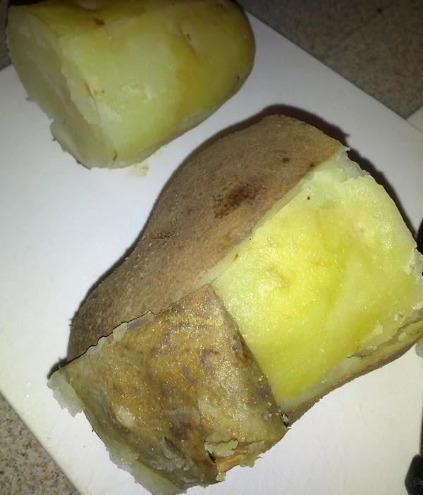 Cut unpeeled potatoes in half. Place in large pot and cover with water. ...