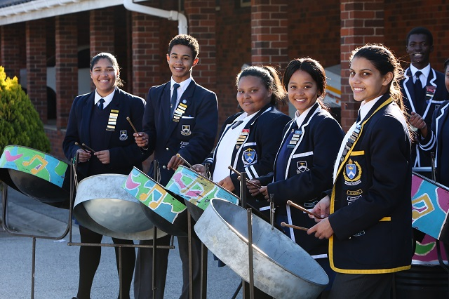 Westering High School Steel band members, from left, Jody Koesnel, 18, Bulelwa Pikinini, 17, and Yeshria Pillay, 18, tune up for the KFC Herald Country Fair on August 25.