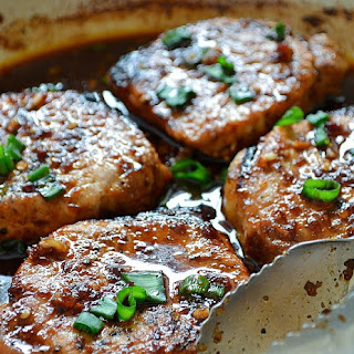 OVEN BAKED PORK CHOPS WITH POTATOES.