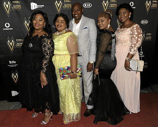 Polygamist Musa Mseleku, seen here with his wives Nokukhanya, Busisiwe, Mbali and Thobile, has welcomed the Constitutional Court ruling. / Veli Nhlapo