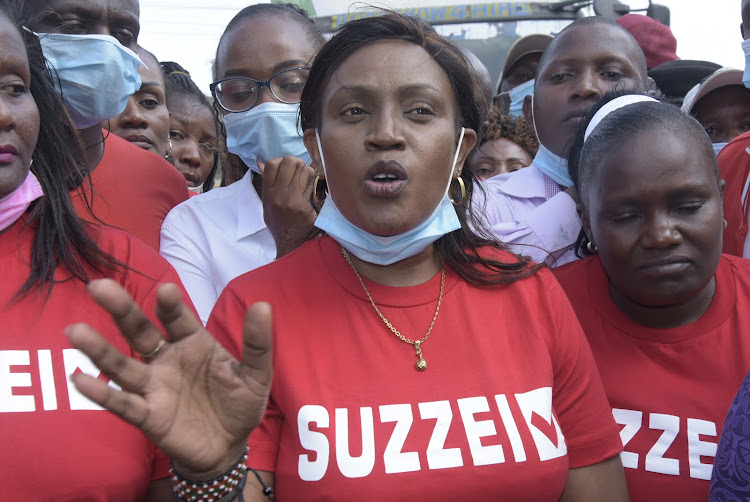 Susan Njeri, widow of former Juja MP Francis Munyua, speaks in Juja town on Monday