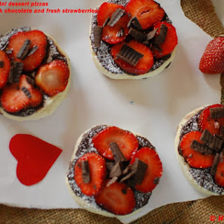 Mini dessert pizzas-Topped with dark chocolate and fresh strawberries.