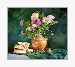 Photo: English dictionary and a bouquet of flowers are on the table