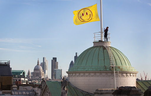 A flag designed by Jeremy Deller and Fraser Muggeridge studio flies above Somerset House as UTOPIA 2016