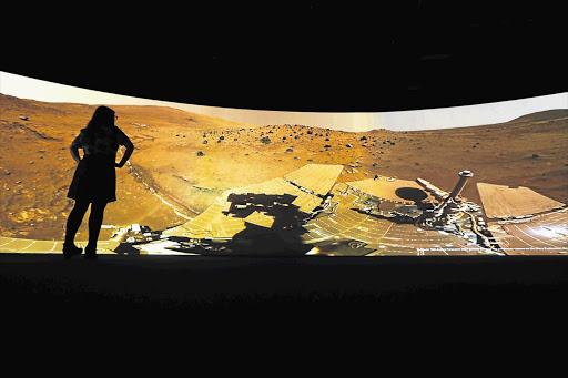 Images of Mars, generated by Nasa's Curiosity rover, on display at the new Visions of the Universe exhibition at the National Maritime Museum, London.