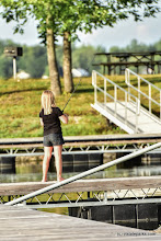 Photo: A young lady fishing from the dock at Burton Island State Park by Raven Schwan-Noble