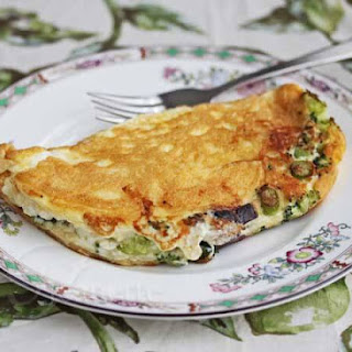 Fluffy Egg White Omelet with Broccoli and Cheddar Cheese.