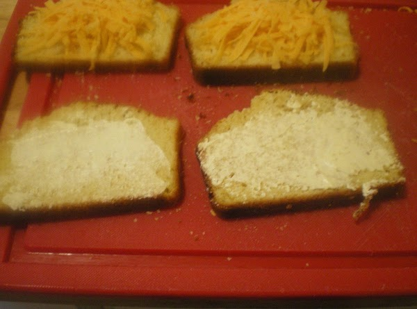 Top with another cornbread slice and butter outside of sandwich.