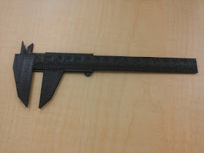 Photo: Easy test for dimensional accuracy: print off some calipers, compare to real ones. It came out quite accurate, but the scale is smudgy because our layer clearance was too low.