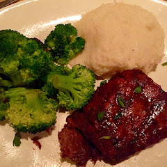 Filet Mignon with garlic mashed potatoes and steamed broccoli.