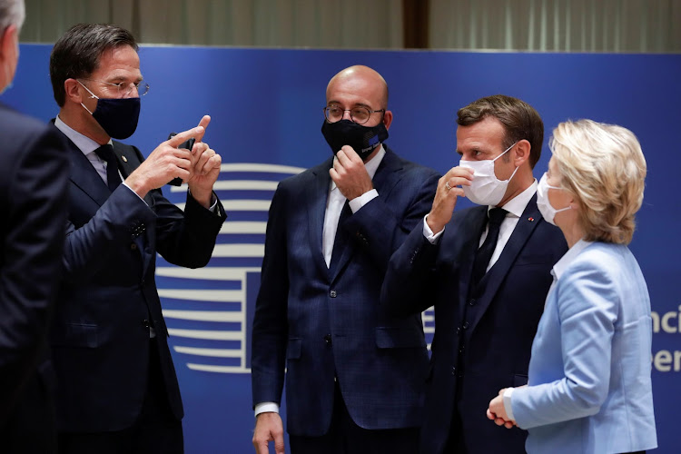 Dutch Prime Minister Mark Rutte, European Council President Charles Michel, French President Emmanuel Macron and European Commission President Ursula von der Leyen interact while wearing face masks during the last roundtable discussion following a four-day European summit at the European Council in Brussels, Belgium, July 21, 2020.