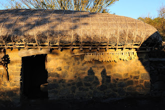 Photo: This hut looks very much like the ones we have seen in Seongeup Folk Village this morning. See the shadow of us?!