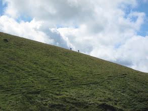 Photo: Later we spot them climbing a ridge.  Fell runners also exist, but we didn't meet any.