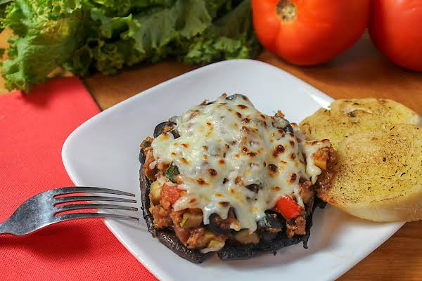 Vegetarian Stuffed Mushroom On A Plate.