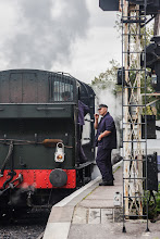 Photo: It wasn't just the train that was puffing  This engineer was sneaking in one last puff on his cigarette before climbing on board to drive the steam engine. Presumably he's not allowed to smoke in the train's cabin for health & safety reasons, though given the amount of smoke, soot and flame coming out of the engine's boiler I'd say this is one of the few jobs where it wouldn't make a lot of difference either way!  This was taken at the Kent & East Sussex Railway line in Tenterden.  #TransportTuesday