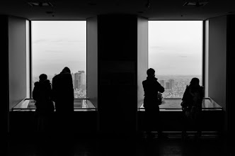 Photo: People look out over Tokyo from the Sunshine Tower in Ikebukuro.