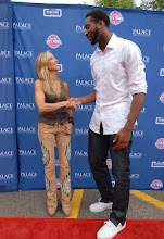Photo: CLARKSTON, MI - AUGUST 12: Sheryl Crow poses with members of the Detroit Pistons at the Palace Sports and Entertainment's Come Together Celebration concert at the DTE Energy Music Theater on August 12, 2012 in Clarkston, Michigan. (Photo by Paul Warner/Getty Images)