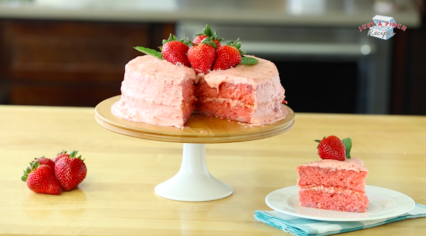 Strawberry Cake On Cake Stand With Piece Cut Out